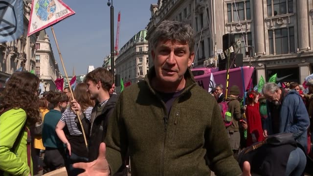 Extinction Rebellion climate change protesters block roads in London ENGLAND London Oxford Circus EXT Reporter to camera SOT