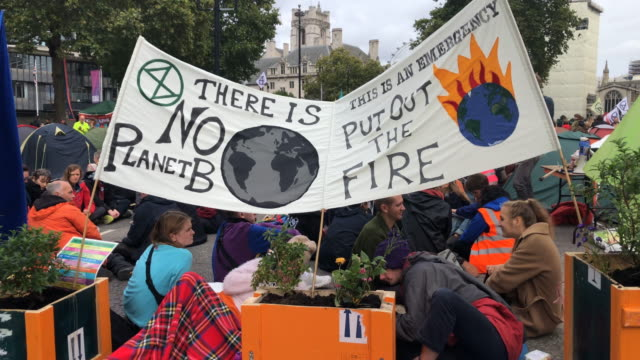 extinction rebellion demonstrators protest in london on october 8 2019 in london england climate change activists are gathering to block access to... - climate activist stock videos & royalty-free footage