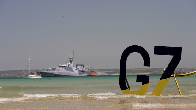 extinction rebellion environmental activists stage with g7 logo in the water on the beach during the g7 summit on june 13, 2021 in st ives, england.... - campaigner stock videos & royalty-free footage