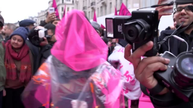 extinction rebellion organised a circus of excess catwalk in oxford circus, london, to highlight the wasteful and disposable nature of the fashion... - fashion industry stock videos & royalty-free footage