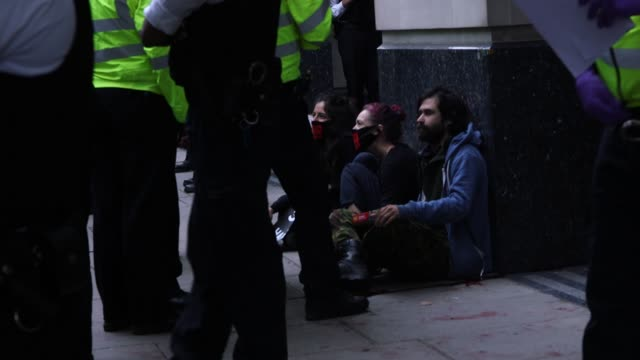 extinction rebellion protest hs2 outside of the department for transport. fake blood has been thrown over the entrance of the building as police... - mode of transport stock videos & royalty-free footage