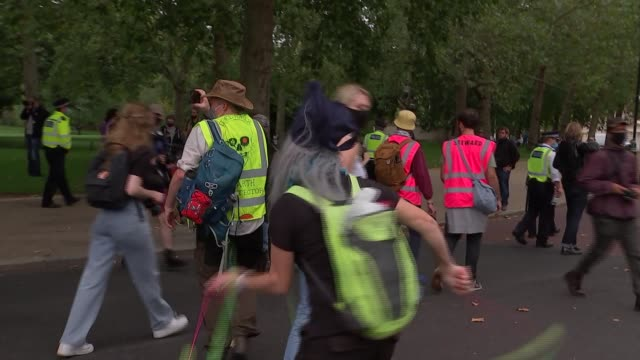 extinction rebellion protest in london; england: london: westminster: ext extinction rebellion protesters marching along with banner, flags and pink... - rucksack stock videos & royalty-free footage