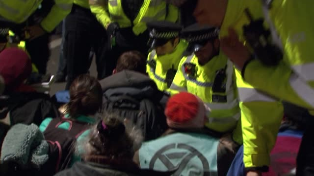 more than 200 climate change activists arrested in london uk london extinction rebellion protesters on waterloo bridge police officers arresting... - yoga stock videos & royalty-free footage