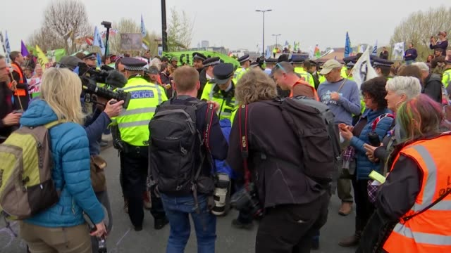 More than 200 climate change activists arrested in London ENGLAND London Waterloo Bridge EXT Wide shot protesters with flags banners and placards...