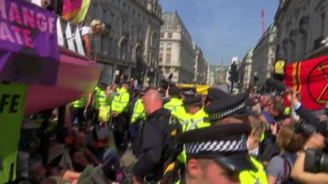 police officers moving in to try and clear main protest sites heathrow and oxford circus london uk various shots of extinction rebellion protesters... - emma thompson video stock e b–roll