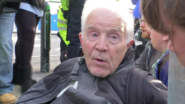 extinction rebellion protesters attempt to shut down london city airport; england: london: london city airport: ext police officers dragging... - protestor stock videos & royalty-free footage
