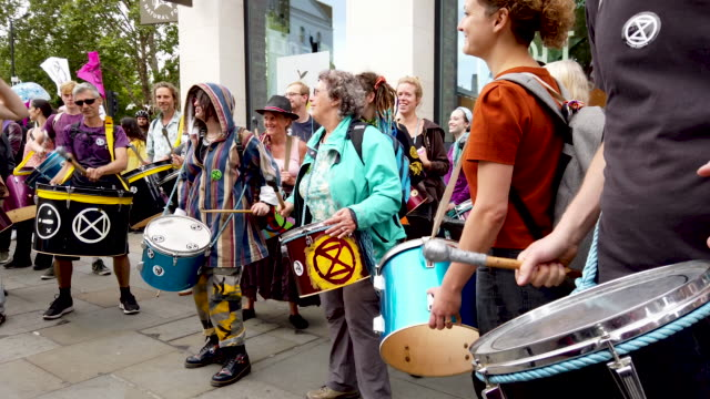 extinction rebellion protesters block traffic on the strand as the environmental protest group begin a series of planned weeklong protests... - social movement stock videos & royalty-free footage