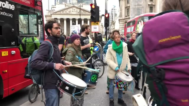 extinction rebellion protesters glue themselves to the stock exchange ahead of planned end of demonstrations england london city of london ext... - bus driver stock videos & royalty-free footage