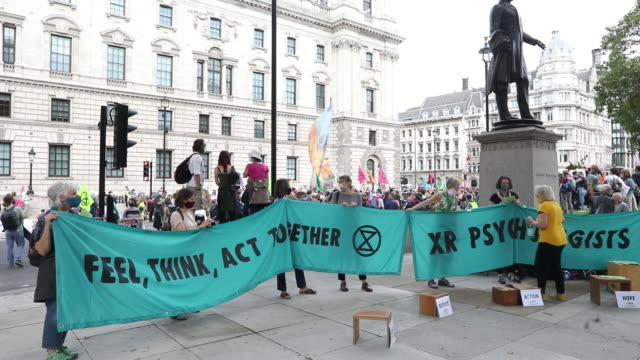 extinction rebellion protestors with banners and flags during a climate change protest organized near parliament square in london uk on tuesday... - road signal stock videos & royalty-free footage