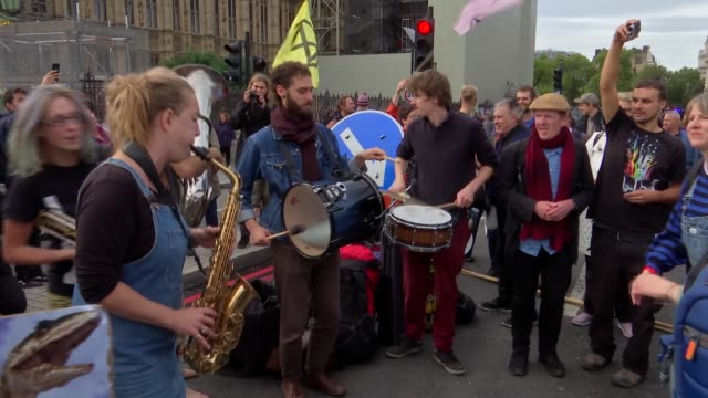 extinction rebellion protests at westminster england london westminster ext extinction rebellion protesters singing clapping and dancing on... - green background stock videos & royalty-free footage