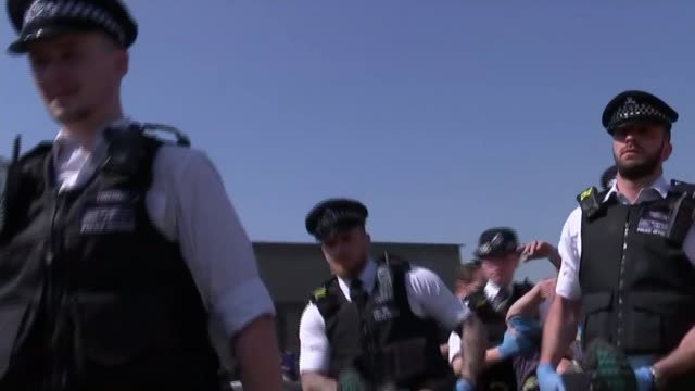 extinction rebellion protests continue for eighth day england london waterloo bridge ext police officers carrying arrested extinction rebellion... - carrying stock videos & royalty-free footage
