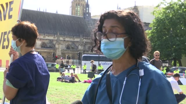 extinction rebellion protests continue in london; england: london: westminster: ext gv two police officers carrying arrested protester gv elderly... - itv london tonight stock-videos und b-roll-filmmaterial