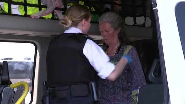 demonstrators to put protests on hold to focus on political negotiation england london waterloo bridge ext police officers carrying arrested... - carrying stock videos & royalty-free footage