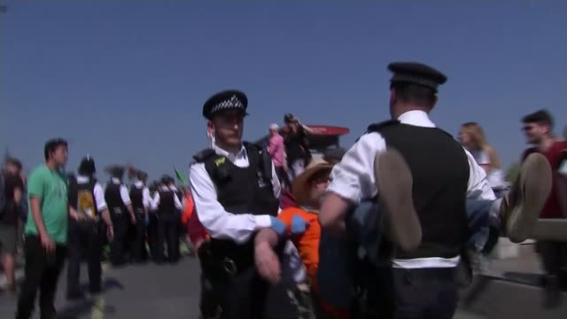 demonstrators to put protests on hold to focus on political negotiation england london waterloo bridge ext police officers carrying protester away... - carrying stock videos & royalty-free footage