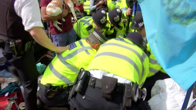 home secretary calls on police to use 'full force of the law' as london protests enter fourth day ** pop music heard over following sequence **... - carrying stock videos & royalty-free footage