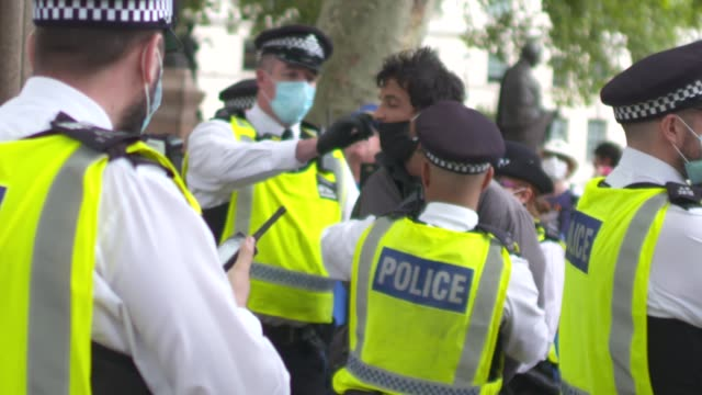 extinction rebellion protests in central london; england: london: westminster: parliament square: ext anti-brexit protesters wearing eu hats with... - arrest stock videos & royalty-free footage