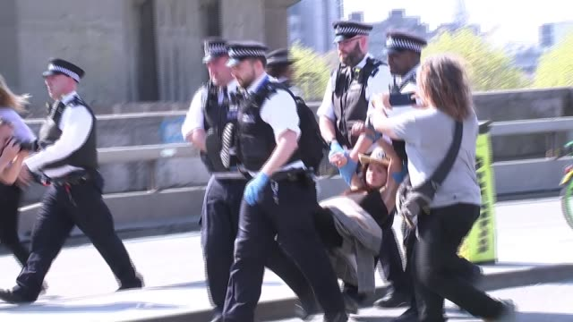 more than 750 arrested after week of climate change protests england london ext police officers talking to protesters sitting in road police officers... - carrying stock videos & royalty-free footage