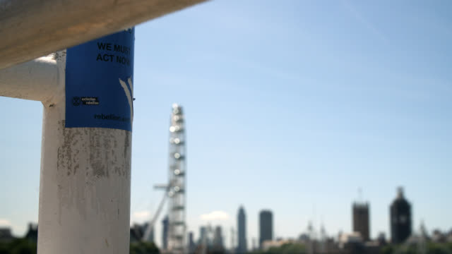 cu extinction rebellion sticker on waterloo bridge - sticker stock videos and b-roll footage