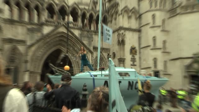 extinction rebellion 'summer uprising' protest outside royal courts of justice england london royal courts of justice ext extinction rebellion woman... - bubble stock videos & royalty-free footage
