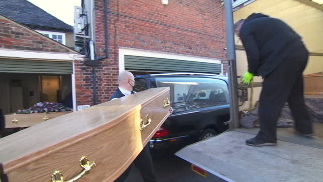 extra delivery of coffins to funeral directors in kent as death rates rise during coronavirus pandemic - infectious disease stock videos & royalty-free footage
