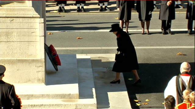 extra security ahead of remembrance day service; lib england: london: whitehall: ext queen elizabeth ii laying wreath at last year's remembrance... - royal marines stock videos & royalty-free footage