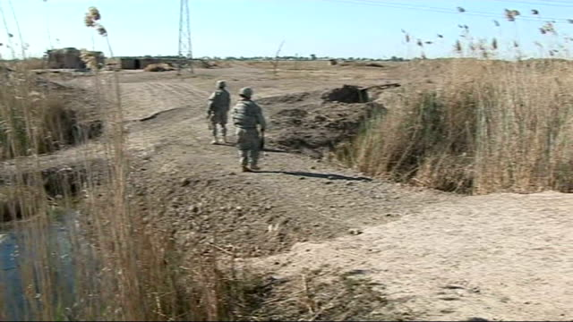 extra us troops in baghdad american soldiers walking over filled in road soldiers telling paton walsh of surprise that moat has been filled in sot - moat stock videos & royalty-free footage
