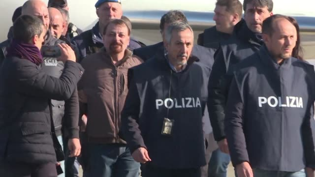 vídeos de stock, filmes e b-roll de extradited former italian communist militant cesare battisti arrives at the rome airport after an international police squad tracked him down and... - ex