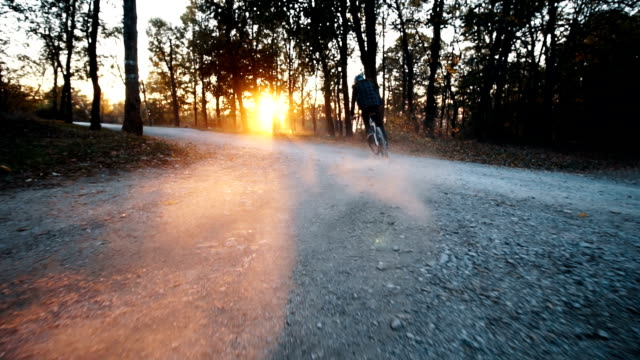 Extreme bicycle riding in sunset