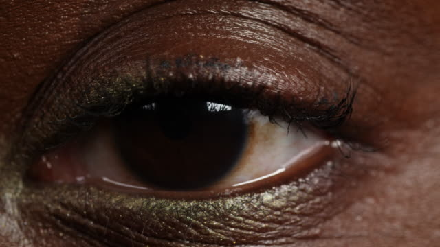 extreme close shot of a woman's left eye. - blinking stock videos & royalty-free footage