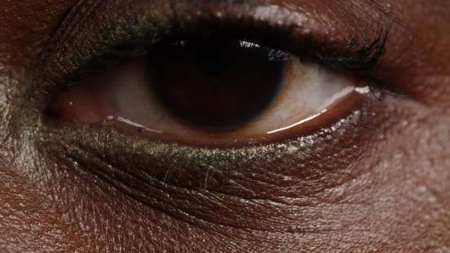 extreme close shot of a woman's left eye. - eyes closed stock videos & royalty-free footage