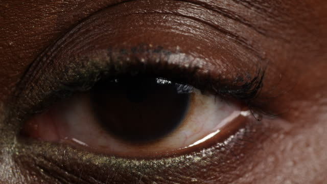 extreme close shot of a woman's left eye. - big brother orwellian concept stock videos & royalty-free footage