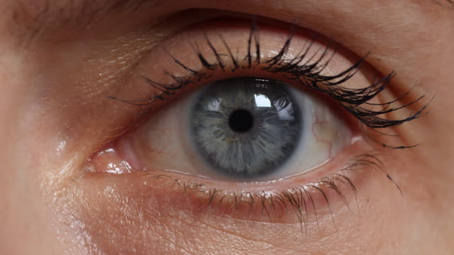 extreme close shot of a woman's left eye. - surveillance stock videos & royalty-free footage