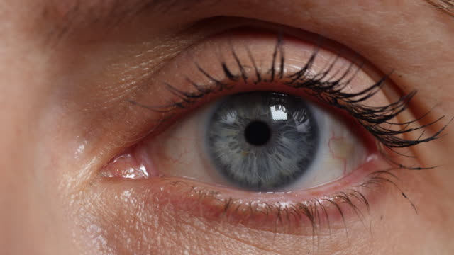 extreme close shot of a woman's left eye. - eyeball stock videos and b-roll footage