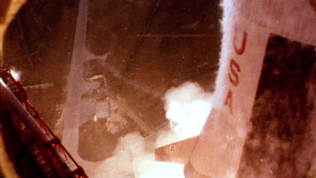 Extreme close up Apollo 11 lifting off from launch pad arm braces breaking off from rocket