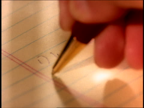 extreme close up ball point pen writing list of business objectives on legal pad - note pad stock videos & royalty-free footage
