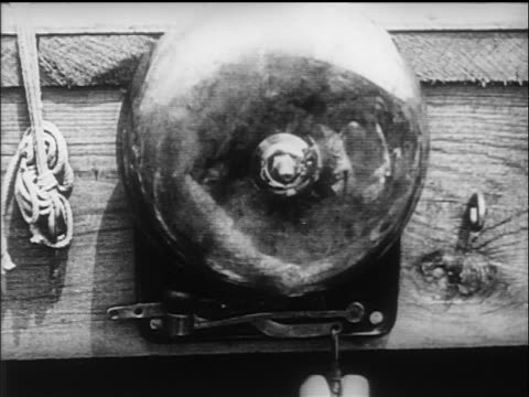 b/w 1919 extreme close up bell being rung in boxing tournament - bell stock videos & royalty-free footage
