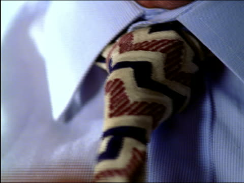 extreme close up black man's hands tightening tie - necktie stock videos & royalty-free footage