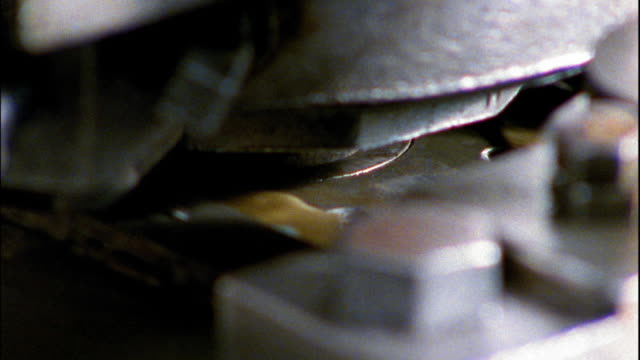 extreme close up blank coins being stamped by machine on assembly line - money press stock videos and b-roll footage