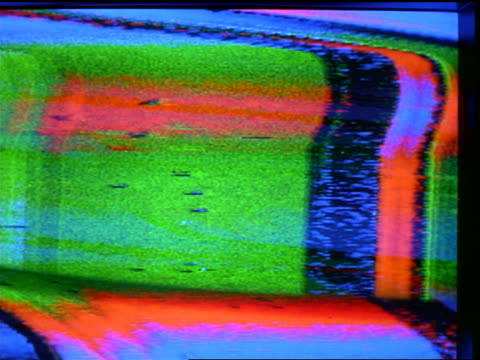 vidéos et rushes de extreme close up blue + green static on television screen with various images in static - 1990 1999