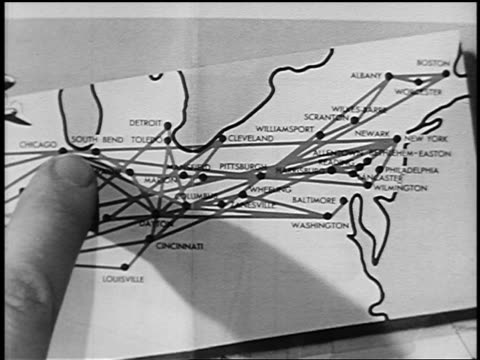 b/w 1951 extreme close up boy's finger pointing on route from chicago to new york on map - yorkville illinois stock videos & royalty-free footage
