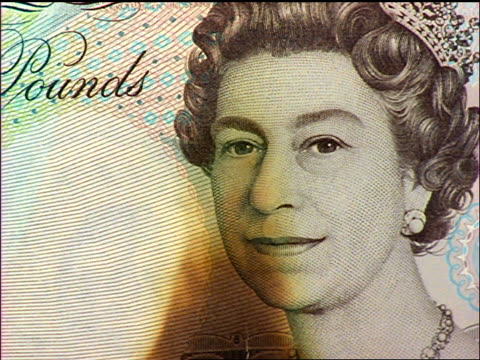 extreme close up burning british five pound note - british pound sterling note stock videos & royalty-free footage