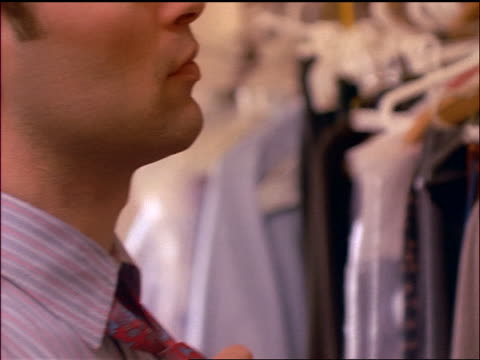 extreme close up businessman tightening tie as he gets dressed - adjusting stock videos & royalty-free footage