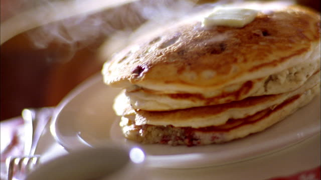 extreme close up butter melting on stack of hot pancakes - pancake stock videos & royalty-free footage