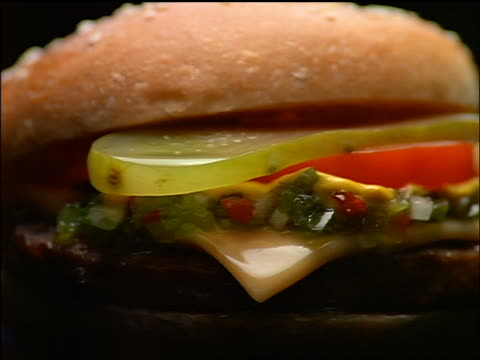 extreme close up cheeseburger with condiments spinning slowly - cheeseburger stock videos & royalty-free footage