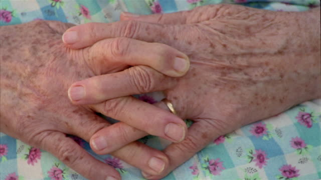 extreme close up clasped hands of an elderly woman - sheppard132 stock videos & royalty-free footage
