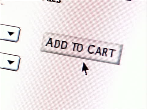 "CANTED extreme close up computer display of pointer clicking ""Add to Cart"" box"