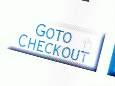 "CANTED extreme close up computer display of pointer moving over ""Go to Checkout"" box"