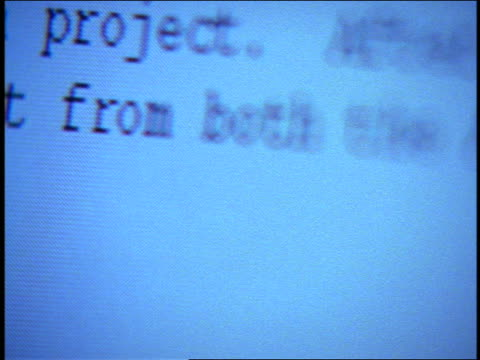 "extreme close up computer display with document in word processor / word ""international"" is typed"