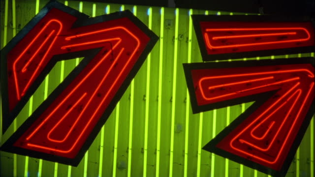 extreme close up detail of a green and red neon sign flashing / tokyo, japan - 2003 stock videos & royalty-free footage