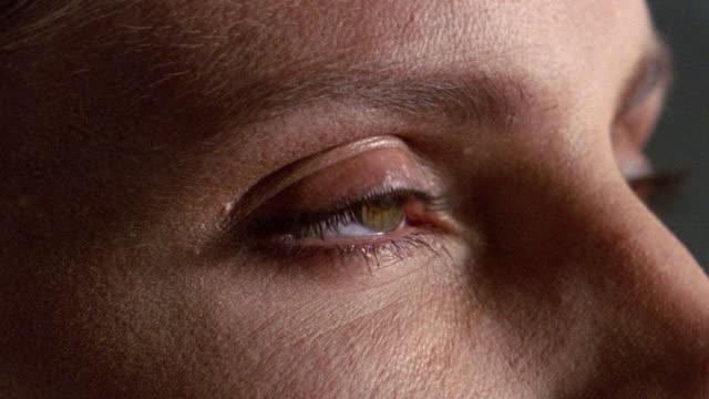 extreme close up eye opening - occhi chiusi video stock e b–roll